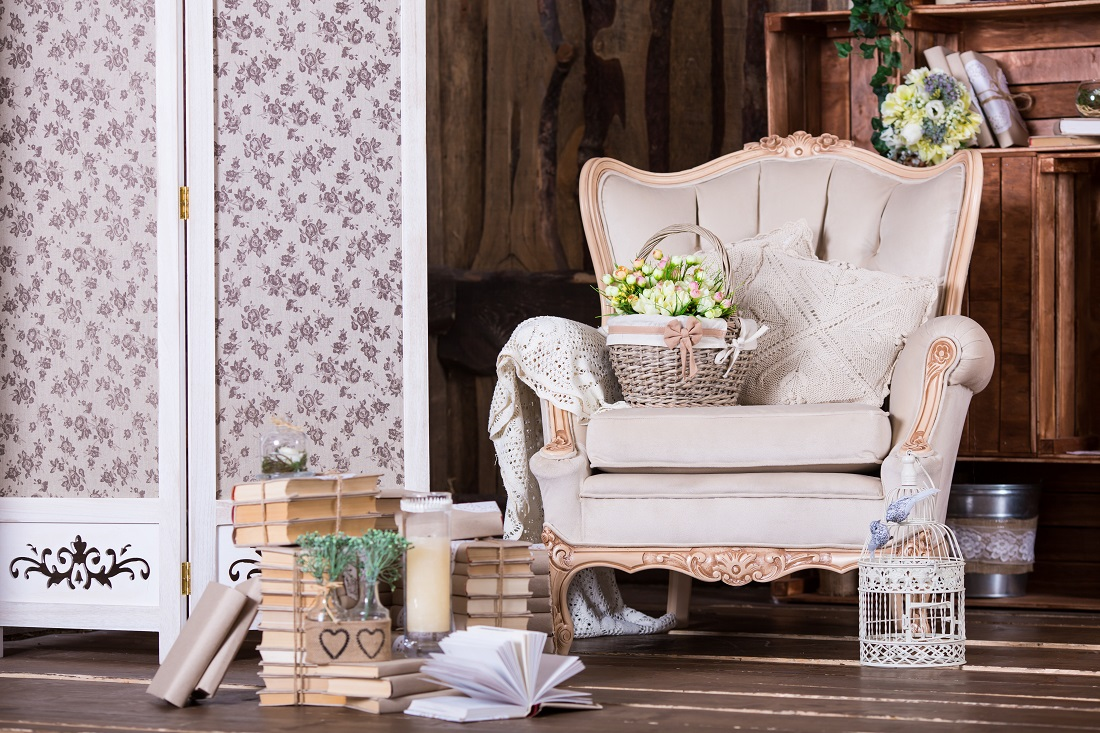 Beautiful vintage interior with old chair and book heaps